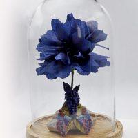 Blauwe Bloem met vlinder